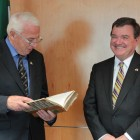 Prof John Kelly (former Executive Director, ICUF) making a presentation to Minister Jim Flaherty in 2012