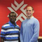 Dr. Solomon Asantey of Fanshawe College greeting James M. Flaherty Scholar William Wilson