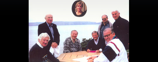 Pictured at the inaugural meeting of the Board of ICUF, Beachy Cove, Newfoundland 1993, from left to right: Professor Noel Walsh (Psychiatry UCD), Dr Patrick Hillery (former President of Ireland), Dr Craig Dobbin O.C. (Chairman and CEO CHC – Canadian Helicopter Corporation), Inset: Mrs Elaine Dobbin, Professor Ken Ozmon ( President of St Marys University Halifax Nova Scotia), Antoin Mac Unfraidh (Irish Ambassador to Canada), Michael Wadsworth (Canadian Ambassador to Ireland), Professor John Kelly (Registrar University College Dublin).
